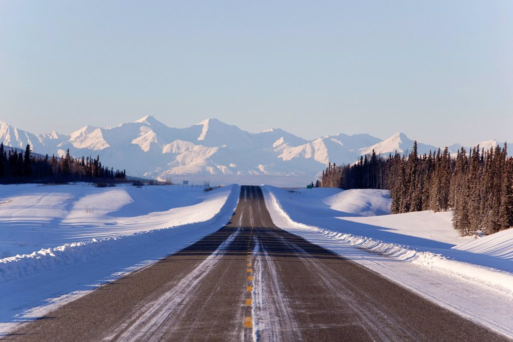 Alaska Highway in winter, St. Elias Mountains behind, Kluane National Park and Reserve, Yukon Territory, Canada : Stock Photo