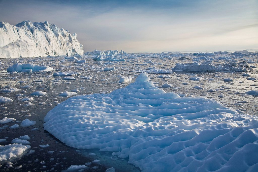 Iceberg shaped by wind and rain, Greenland : Stock Photo
