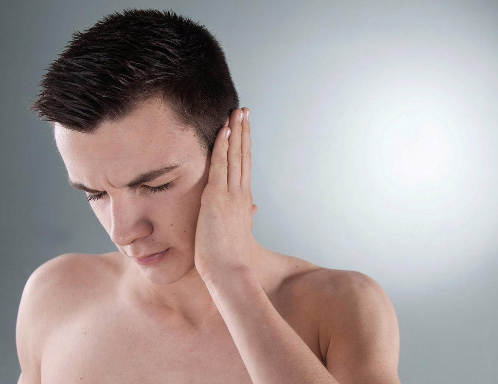 Young man with ear pain : Stock Photo