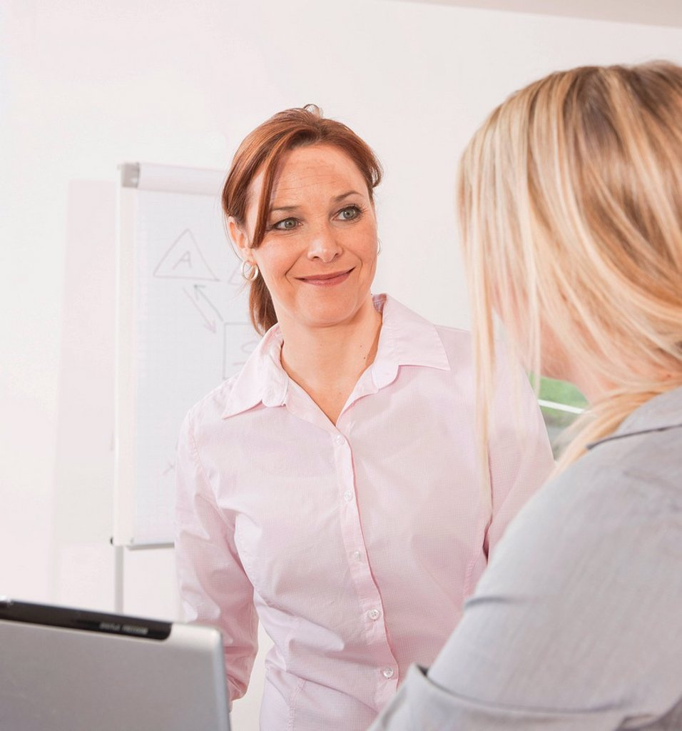 Two women in an office : Stock Photo