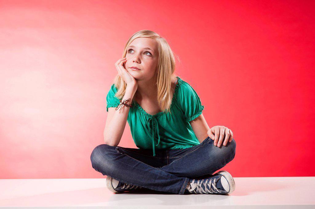 Girl sitting cross_legged : Stock Photo