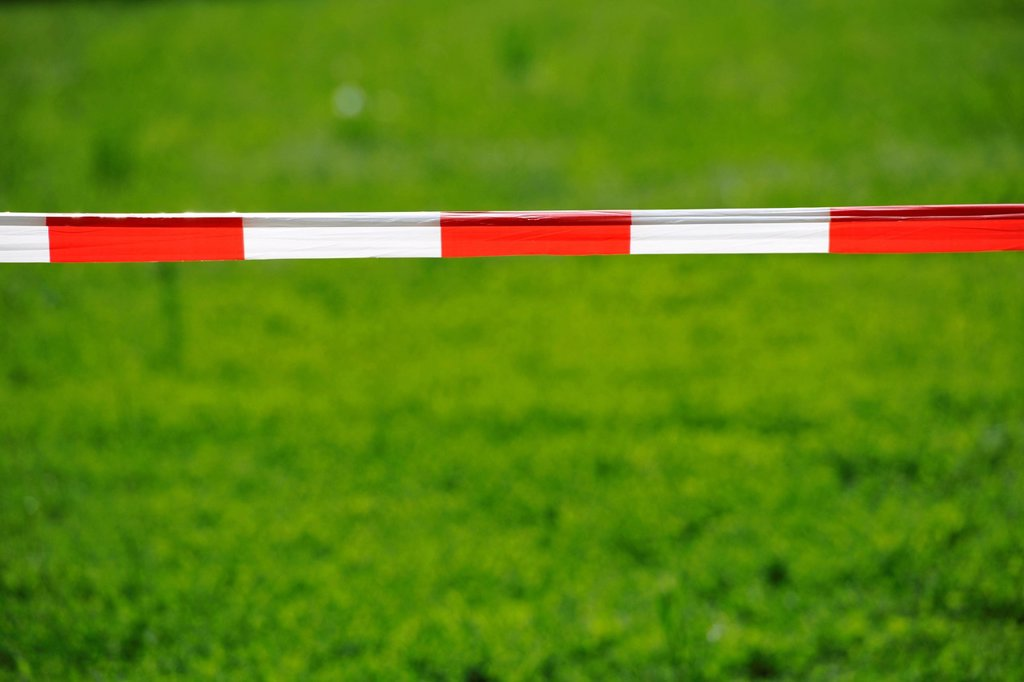 Stock Photo: 1848R-641596 Bandrole, warning tape, red and white, front lawn