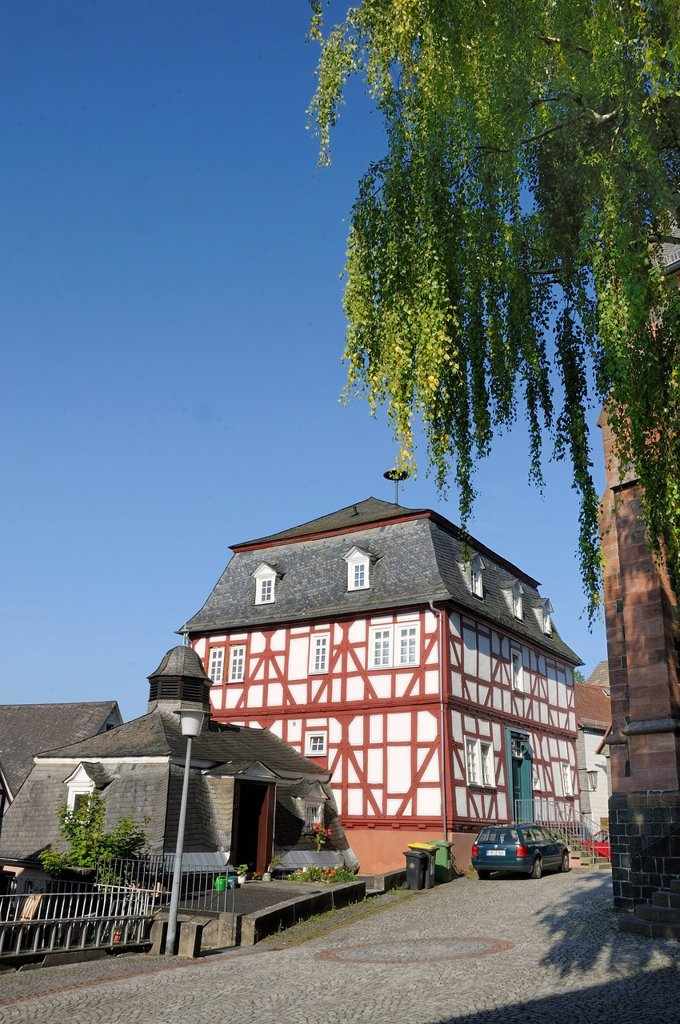 Stock Photo: 1848R-643459 Oldest Town Hall and half_timbered building in the historic town centre of Biedenkopf, with the Wilden Mann or Hessenmann in the half_timbered building and the old brewery in the foreground, Hinterland, district of Marburg_Biedenkopf, Hesse, Germany, Euro