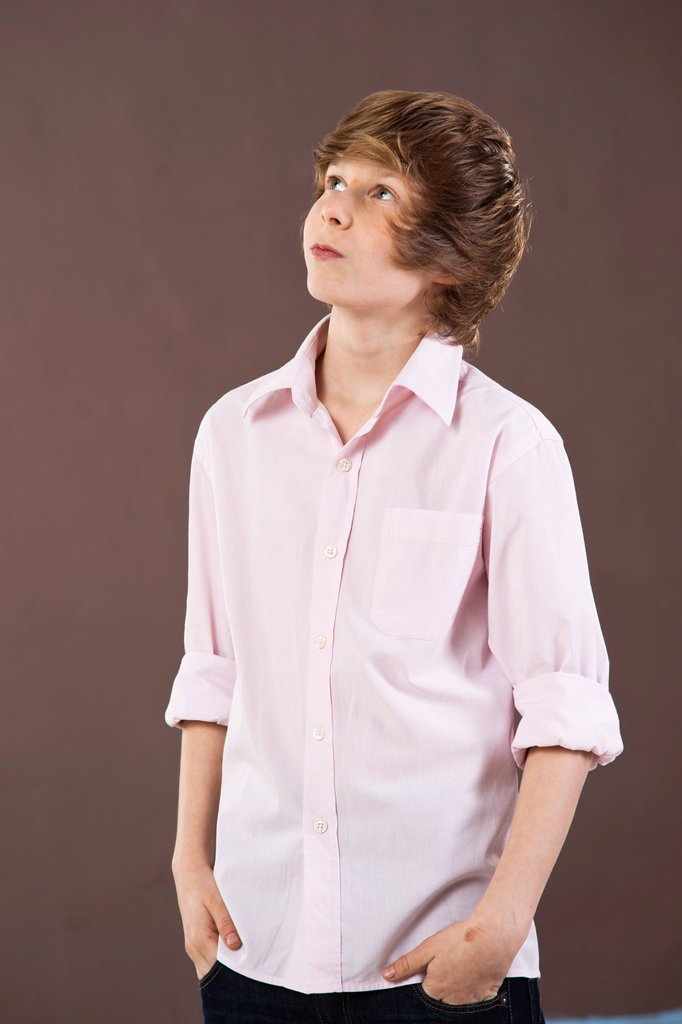 Stock Photo: 1848R-643474 Boy looking up with a contemplative expression