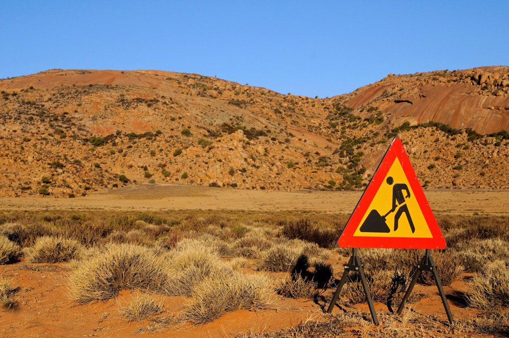 Warning sign for a construction site in the desert, Goegap Nature Reserve, Namaqualand, South Africa, Africa : Stock Photo