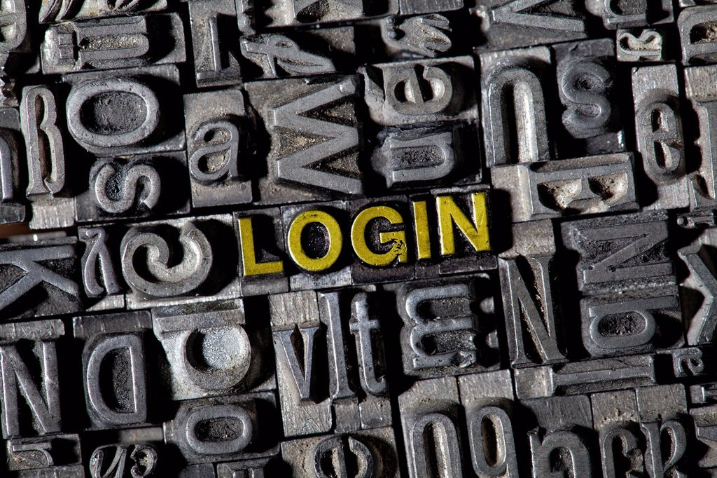 Old lead letters spelling the word ´´LOGIN´´ : Stock Photo