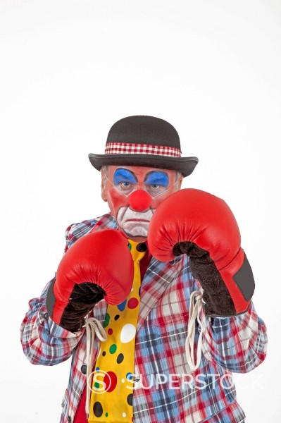 Stock Photo: 1848R-727165 Clown wearing boxing gloves