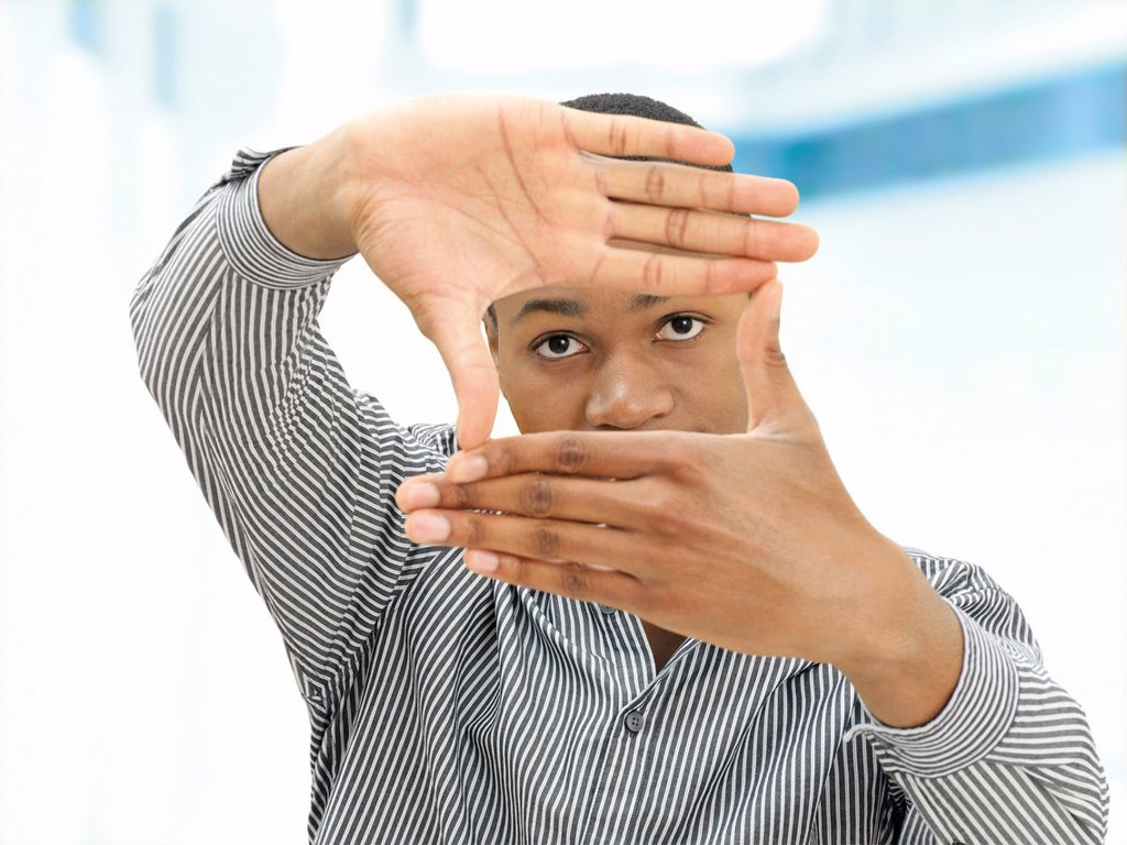 Stock Photo: 1848R-727207 Young man, African_American, American, his hands shaping a rectangle in front of his face, gesture