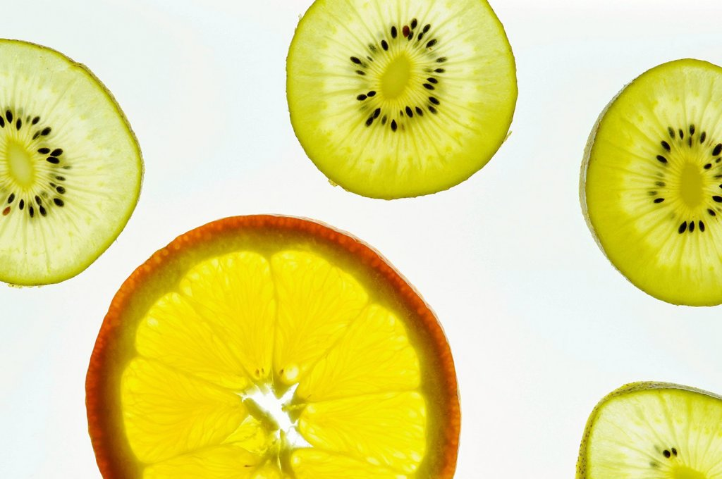 Orange slice, kiwi slices : Stock Photo