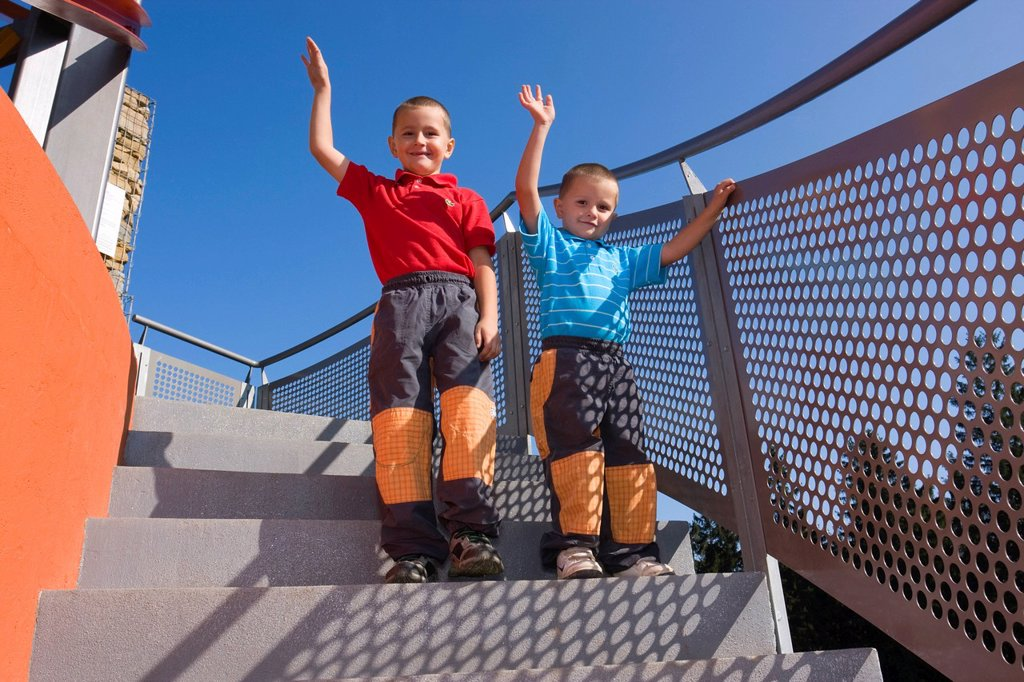Boys, 6 and 4 years, on a staircase : Stock Photo