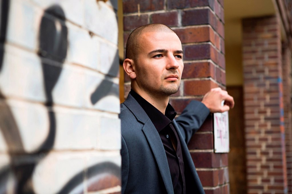 Stock Photo: 1848R-738798 Young man in urban setting, portrait