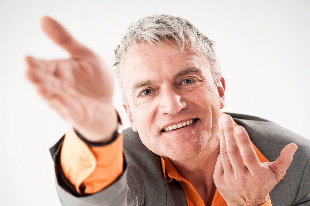 Stock Photo: 1848R-739772 Smiling businessman, gesticulating