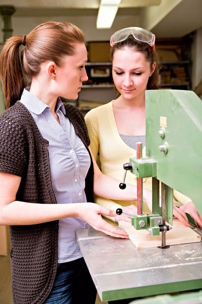 Stock Photo: 1848R-739931 Young female teacher and a teenage schoolgirl in the handwork classroom