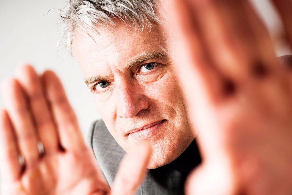 Businessman gesticulating defensively : Stock Photo