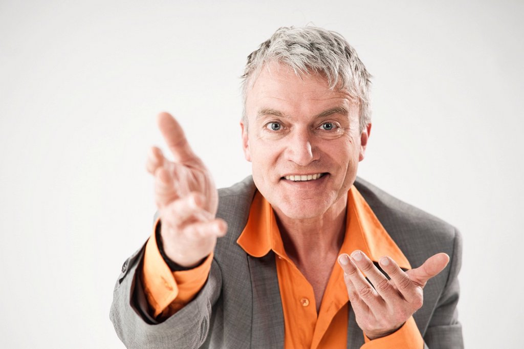 Smiling businessman, gesticulating : Stock Photo