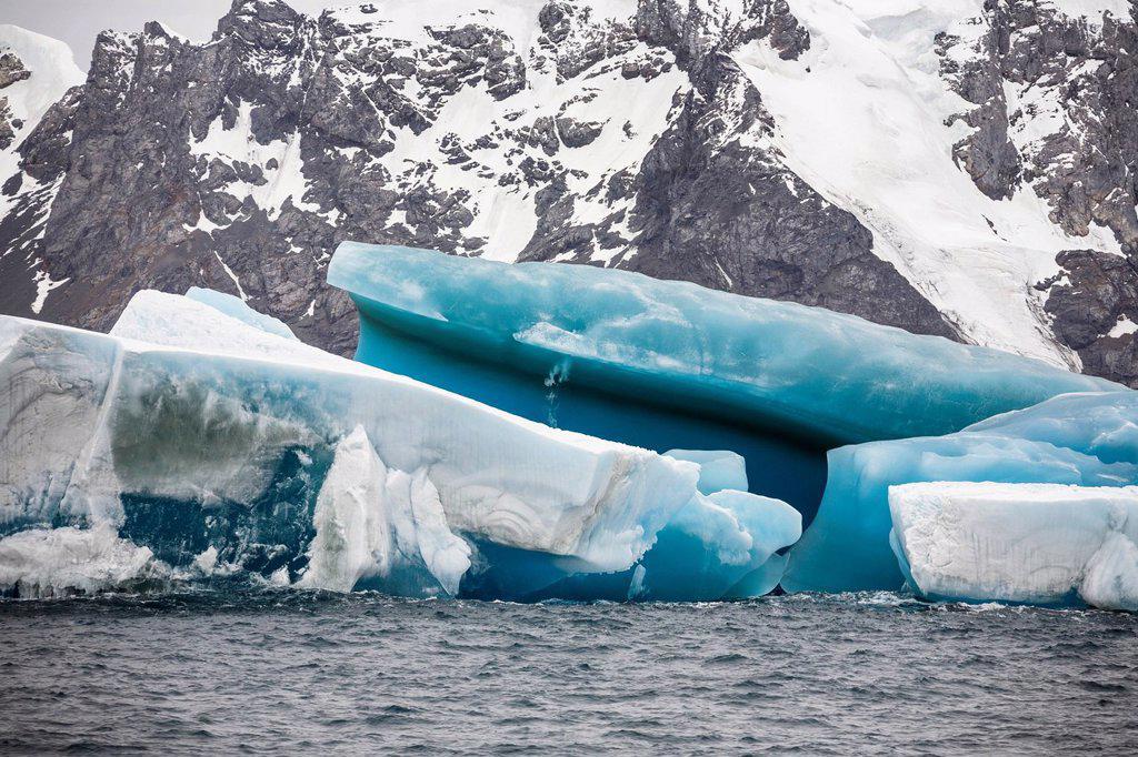 Blue iceberg off Laurie Island, Washington Strait, South Orkneys, Southern Ocean, Antarctica : Stock Photo