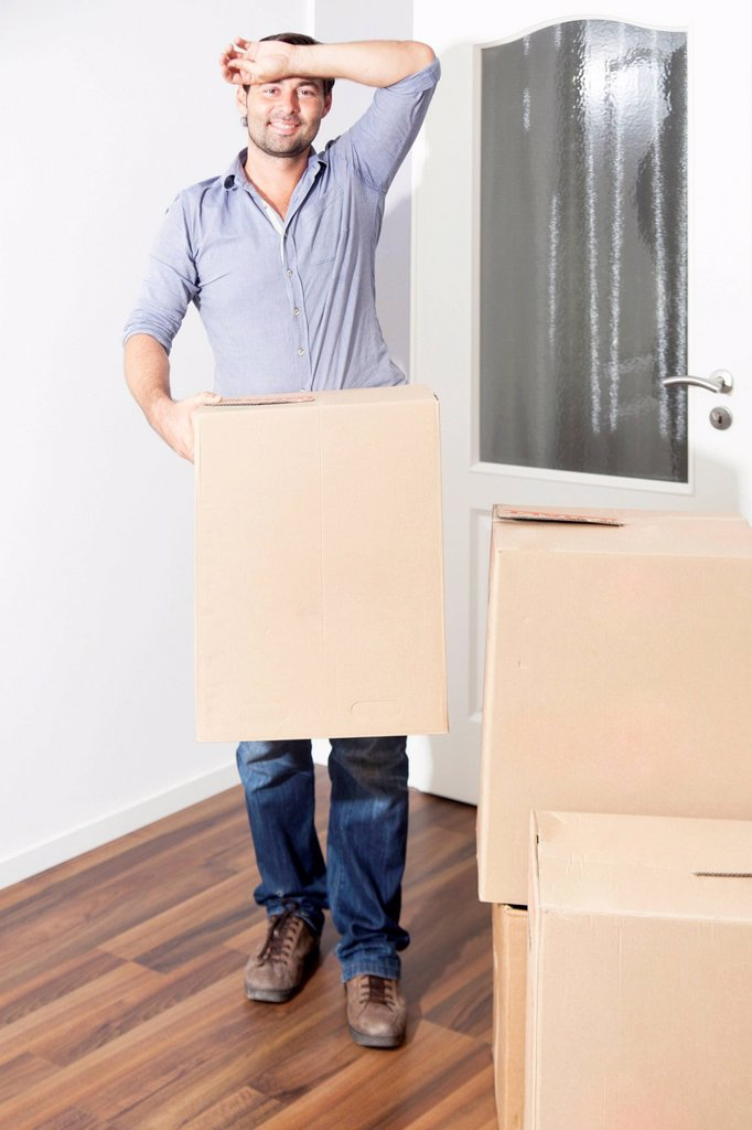 Stock Photo: 1848R-753705 Man moving house