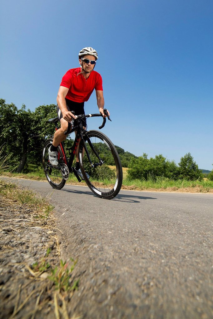 Stock Photo: 1848R-799097 Cyclist, 44 years, riding a racing cycle