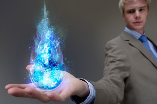 Stock Photo: 1849-1016 Businessman holding glowing ball