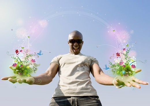 African man holding flowers and vines : Stock Photo