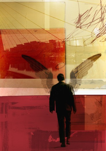 Businessman with wings walking in urban setting : Stock Photo