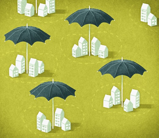 Umbrellas protecting groups of houses : Stock Photo