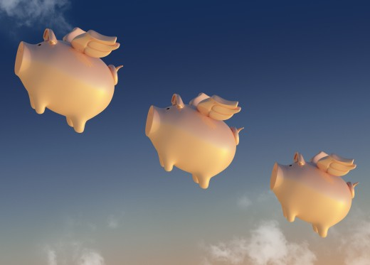 Flying piggy banks : Stock Photo