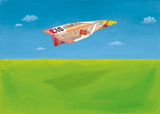 British 10 pound note in shape of airplane : Stock Photo