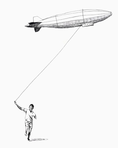 Boy pulling blimp : Stock Photo