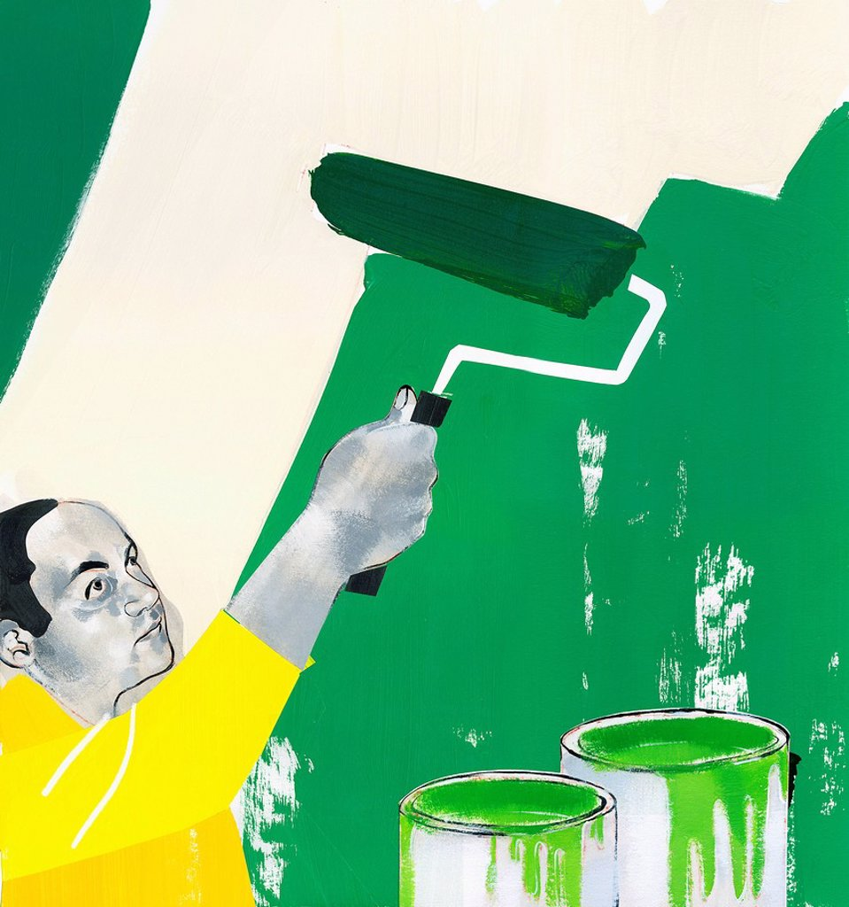 Man painting wall green : Stock Photo