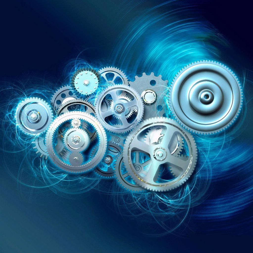 Group of cogs turning together : Stock Photo