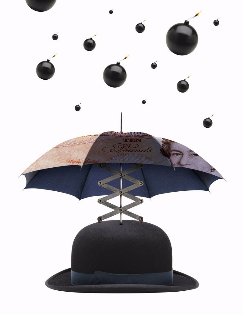 Bombs dropping on umbrella bowler hat : Stock Photo