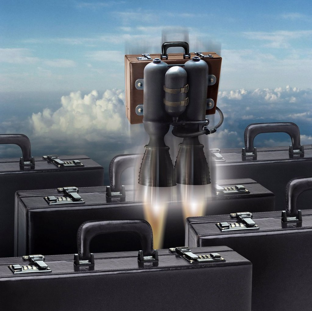 Stock Photo: 1849-2906 Briefcase with rocket attached