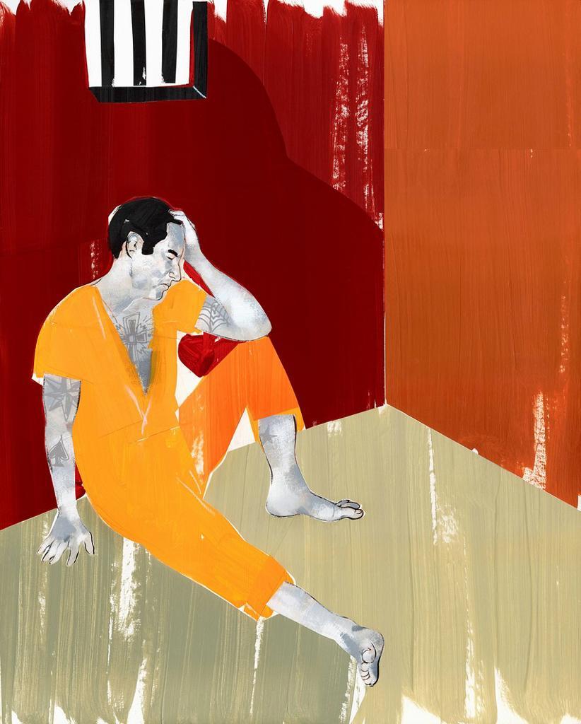 Man sitting on floor of jail cell : Stock Photo