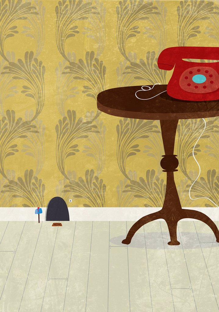 Mouse hole next to table and telephone : Stock Photo