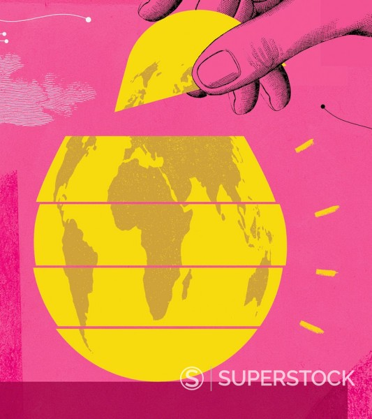 Hand placing final piece of golden egg-shaped globe into formation : Stock Photo