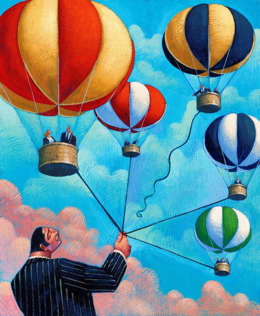 Stock Photo: 1849-3388 Businessman holding bunch of hot air balloons and letting one go