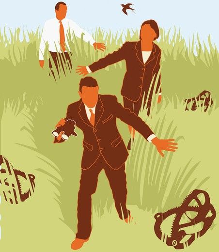 Stock Photo: 1849-459 Businesspeople avoiding traps in grass