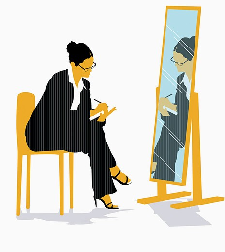 Businesswoman looking in mirror : Stock Photo