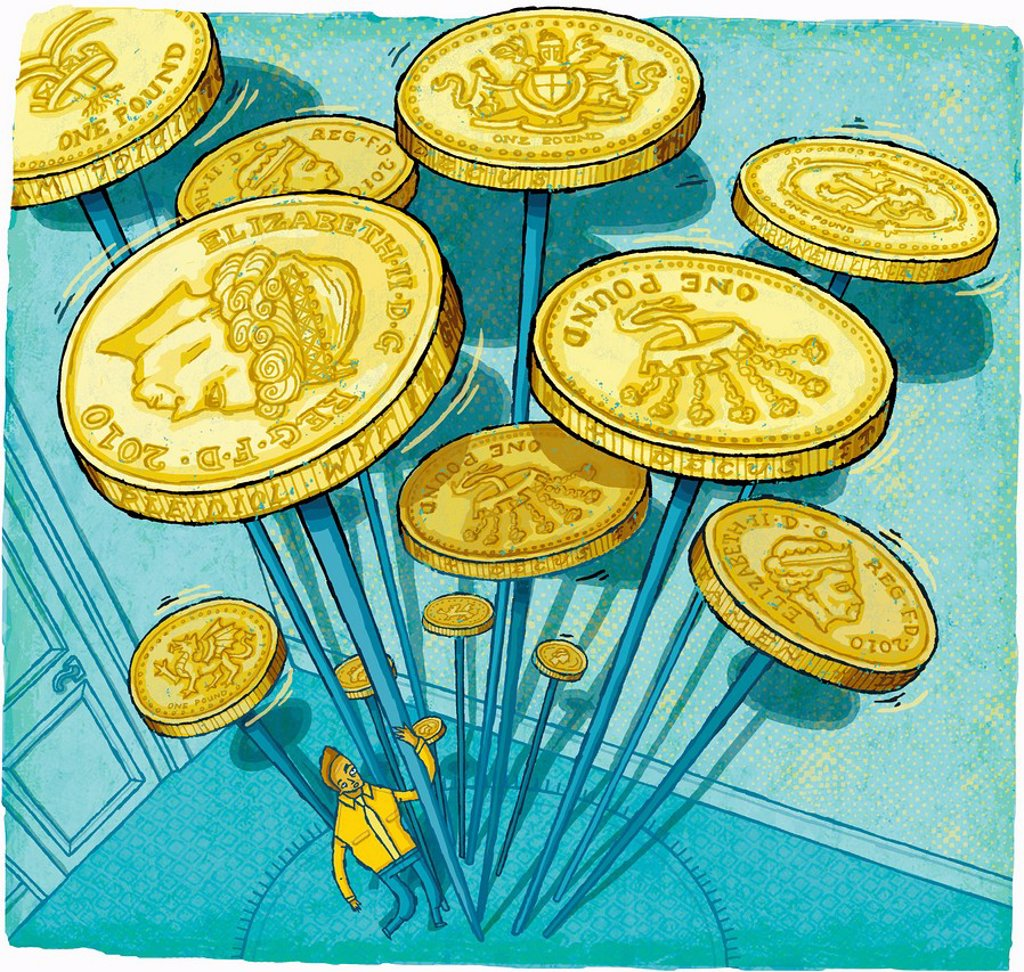 Businessman struggling to spin British pound coins on sticks : Stock Photo