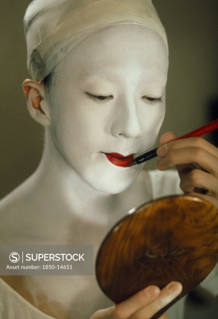 Stock Photo: 1850-14651 Japan, Traditional Theatre, Kabuki Actor Applying Make Up.  Female Actors Are Banned As Immoral And Their Roles Taken By Male Onnagata Or Female Role Specialists.