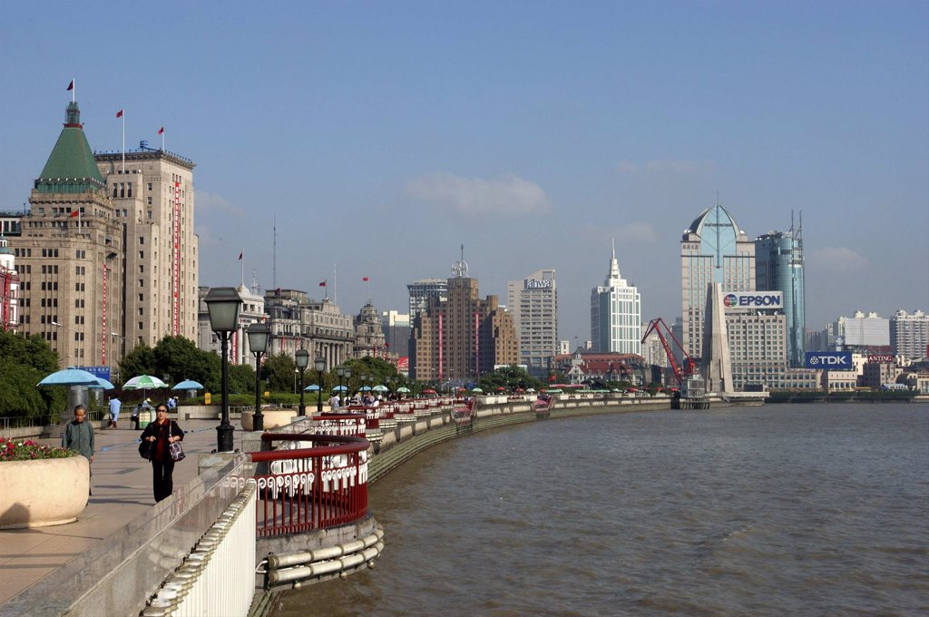 Stock Photo: 1850-10181 China, Shanghai, The Bund Aka Zhong Shan Road. View Along The Promenade That Runs Along The Huangpu River With The City Skyline In The Distance