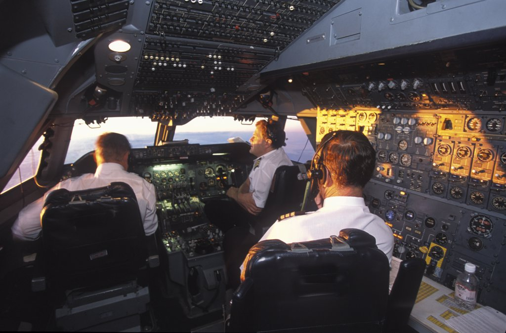 Stock Photo: 1850-10328 South Africa, Central, South African Airways Boeing 747 300 Cockpit With Pilot And Crew At Daybreak Over Central Africa On A Flight From London To Cape Town