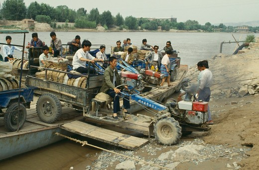 Stock Photo: 1850-1039 China, Yellow River, Men Taking A Tractor Off A Ferry