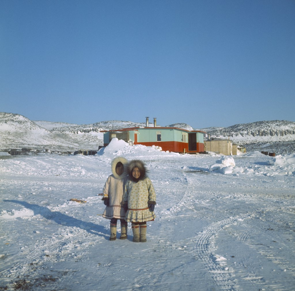 Canada, Nunavut, Baffin Island, Young Innuit Girls Outside Settlement. : Stock Photo