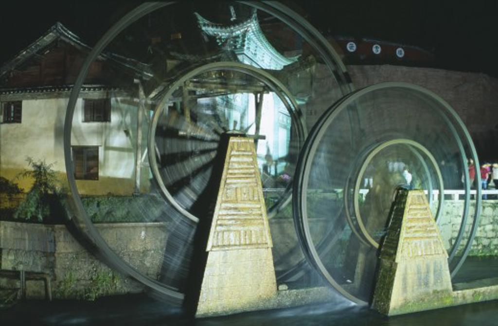 Stock Photo: 1850-11613 China, Yunnan, Lijiang, Waterwheel At Night.