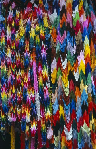 Japan, Honshu, Hiroshima, Peace Memorial Park. Mass Of Multi Coloured Origami Cranes At The Childrens Peace Monument : Stock Photo
