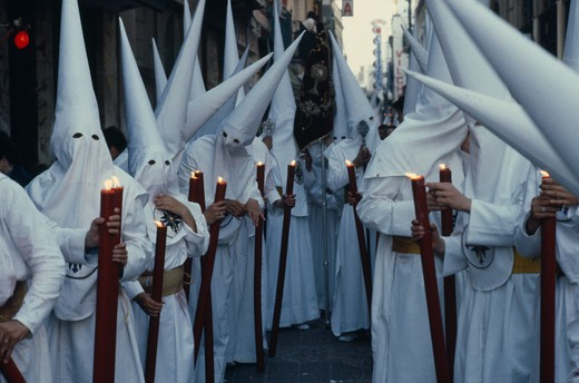 Spain, Andalucia, Seville, Penitents In Holy Week Procession : Stock Photo