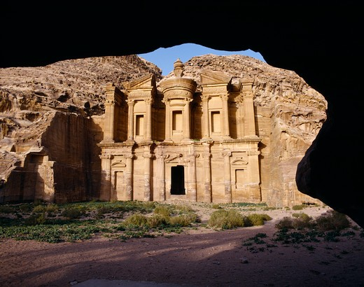 Jordan, Petra, The Monastery Carved From Rock Face Framed By Rock Arch. : Stock Photo