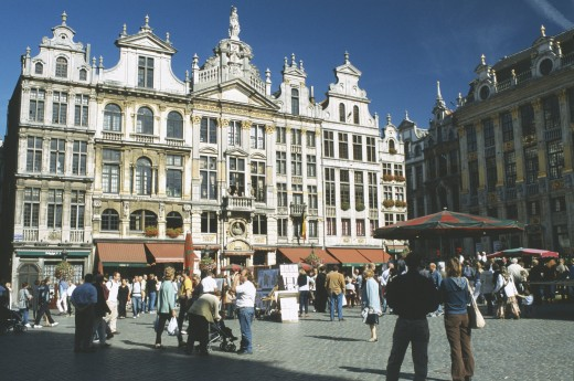 Stock Photo: 1850-12408 Belgium, Brussels, Grand Place Lined With Cafes With Crowds Of People And Stalls.